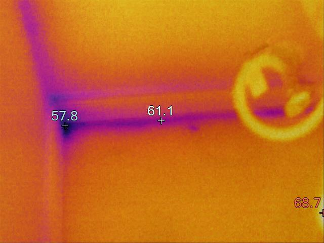 thermal image of toilet supply line leaking behind wall